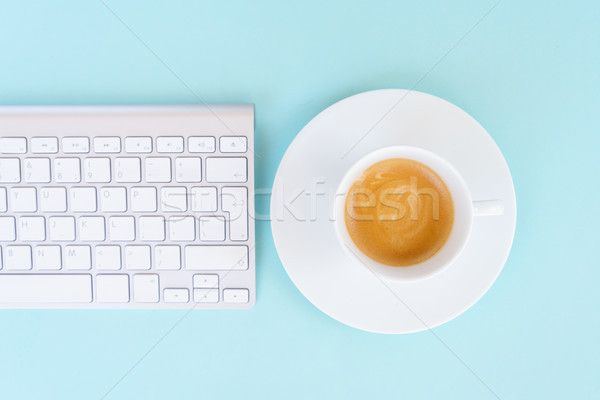 Flat lay home office workspace on blue Stock photo © neirfy