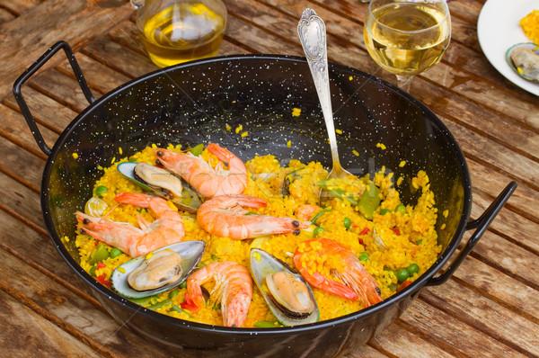 Seafood paella in black pan Stock photo © neirfy