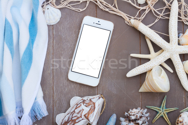 phone with beach towel and seashells Stock photo © neirfy