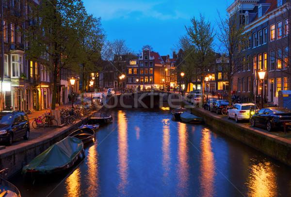 Huizen Amsterdam Nederland brug kanaal water Stockfoto © neirfy