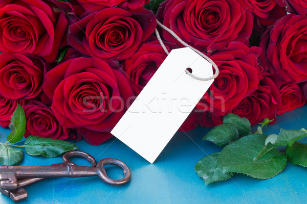 crimson roses with empty tag Stock photo © neirfy