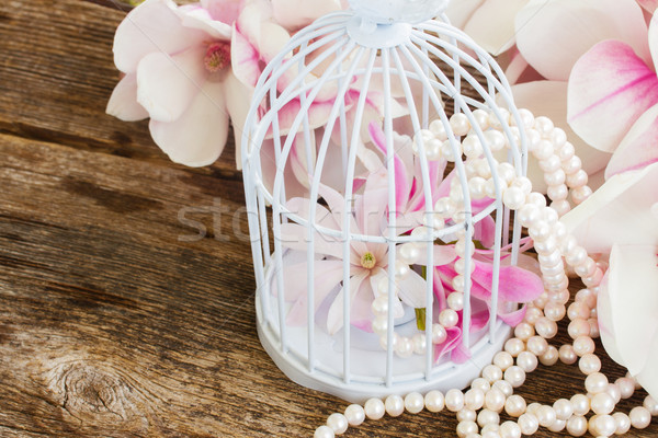magnolia flowers with pearls on wooden table Stock photo © neirfy