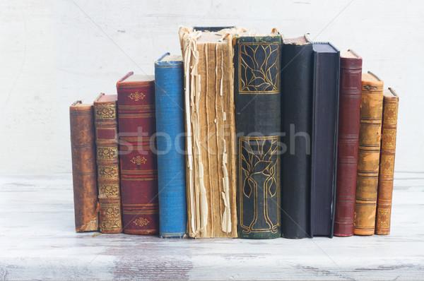 Szett könyvek fehér fából készült asztali iskola Stock fotó © neirfy