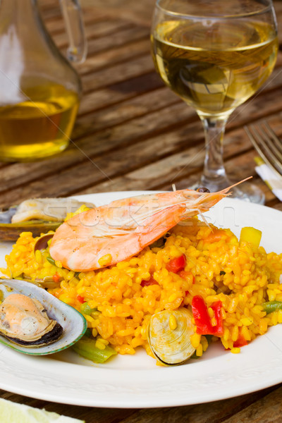Dining with paella Stock photo © neirfy
