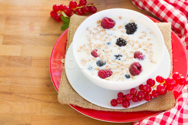 Plate of  oat flakes with berries Stock photo © neirfy