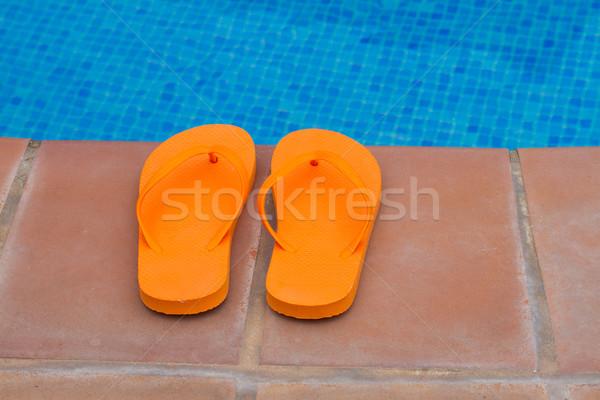 Narancs papucs medence perem tengerpart víz Stock fotó © neirfy
