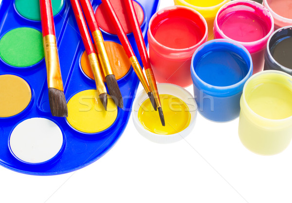 colorful paints and brushes Stock photo © neirfy