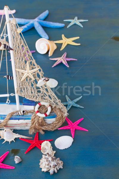 Seashells,  starfish and boat Stock photo © neirfy