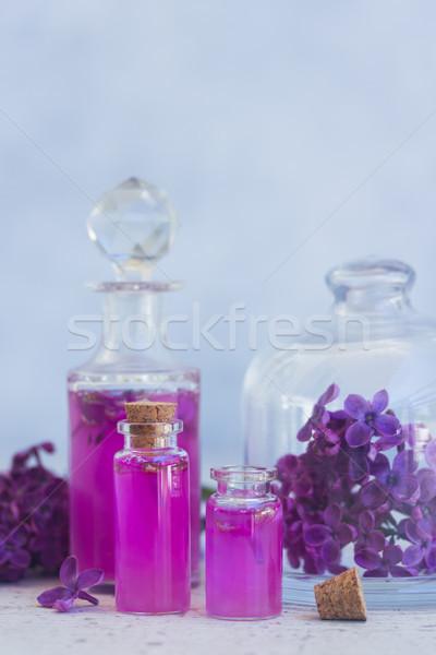 Lila esencia vidrio frescos flores gris Foto stock © neirfy