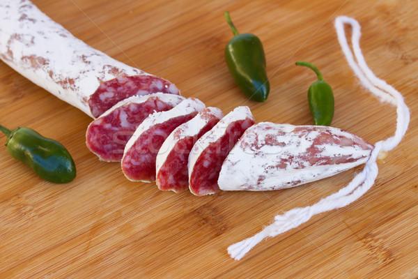 Stockfoto: Spaans · worst · worstjes · groene · paprika · houten · tafel