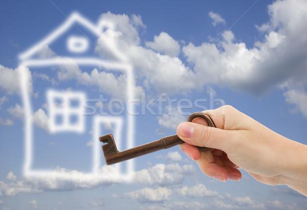 Nieuw huis hand sleutel abstract home huis Stockfoto © neirfy