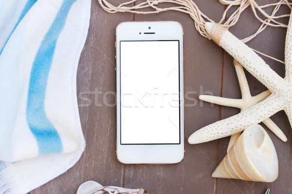 Teléfono toalla de playa blanco espacio de la copia vacío Foto stock © neirfy