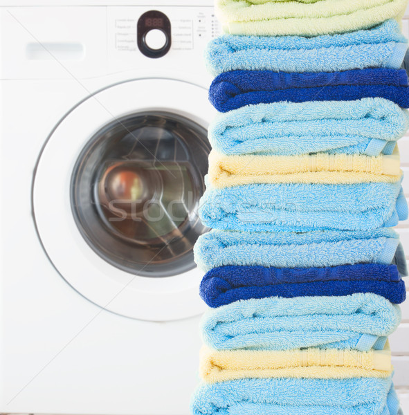 pile of clean towels with washing machine Stock photo © neirfy