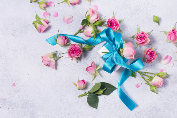 Stock photo: Gift box with satin bow and flowers