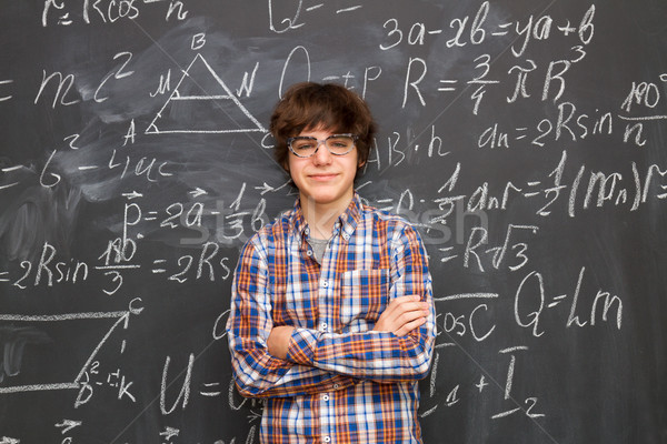 Boy and blackboard filled with math formulas Stock photo © neirfy