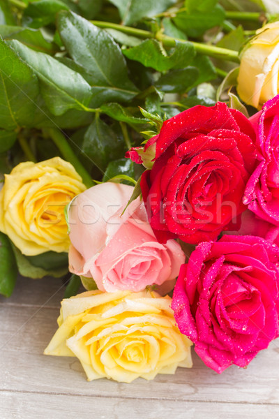 yellow and pink  roses  on table Stock photo © neirfy
