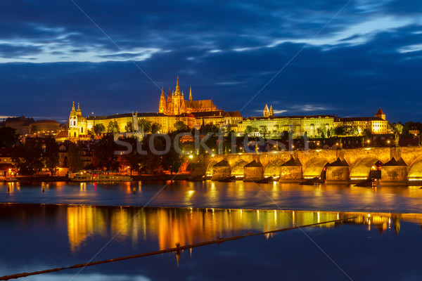 skyline of Prague with Vitus cathedral and Charles bridge Stock photo © neirfy