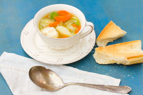 Fish soup with silver spoon Stock photo © neirfy