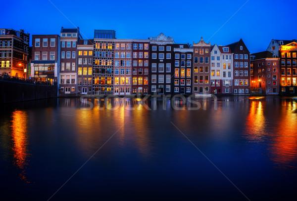 Häuser Amsterdam Niederlande Kanal Reflexionen beleuchtet Stock foto © neirfy
