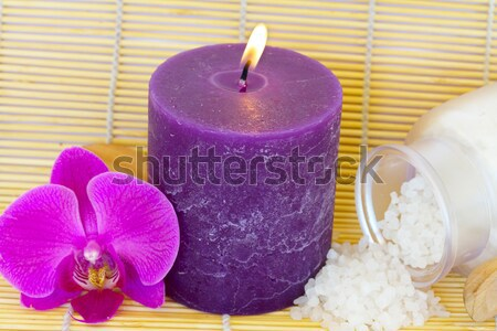 candle on mat with sea salt and flowers Stock photo © neirfy