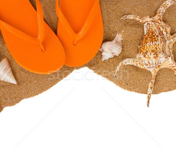 Naranja sandalias conchas arena frontera aislado Foto stock © neirfy