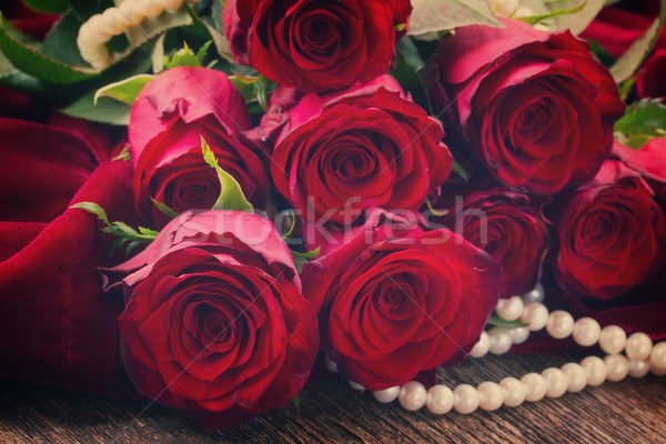 red roses on velvet Stock photo © neirfy