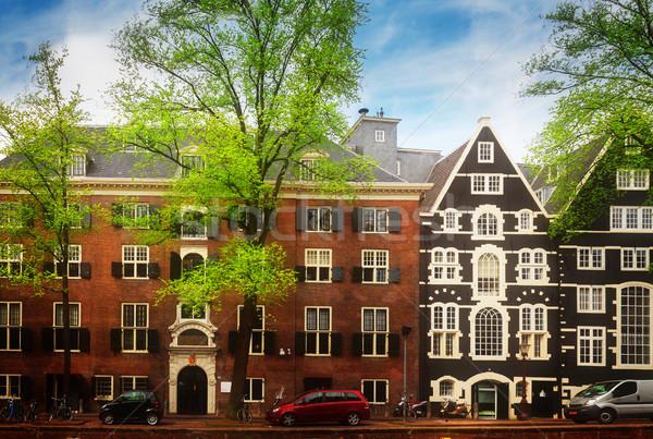 Oude huizen Amsterdam kanaal Nederland retro Stockfoto © neirfy