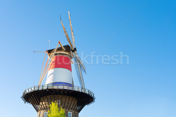 Moulin à vent Pays-Bas trois pavillon holland Photo stock © neirfy