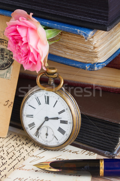 antique clock on old  books and letters background Stock photo © neirfy
