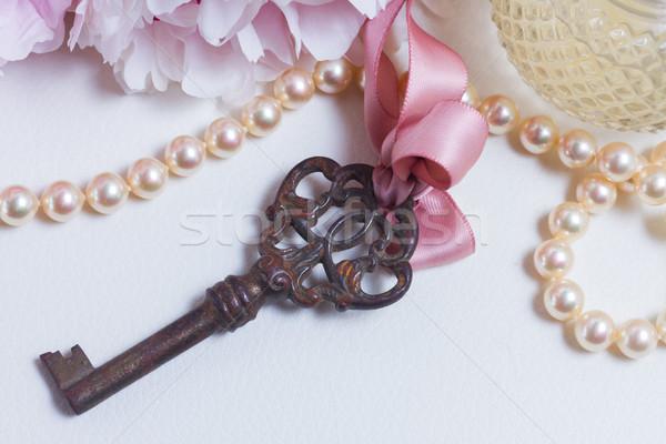 Skeleton key with peony flowers Stock photo © neirfy