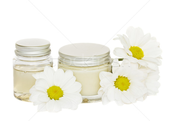 jars with cream and camomile Stock photo © neirfy