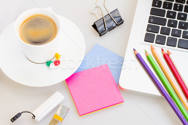 Laptop with office suply and cup of coffee Stock photo © neirfy