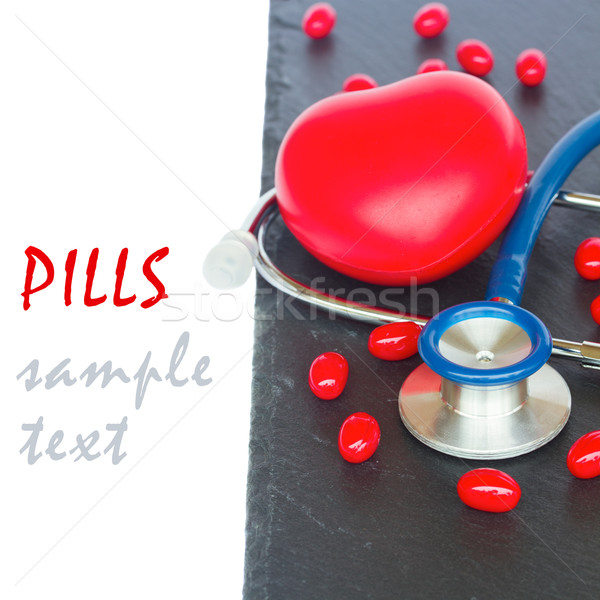 stethoscope with red  pills and heart Stock photo © neirfy