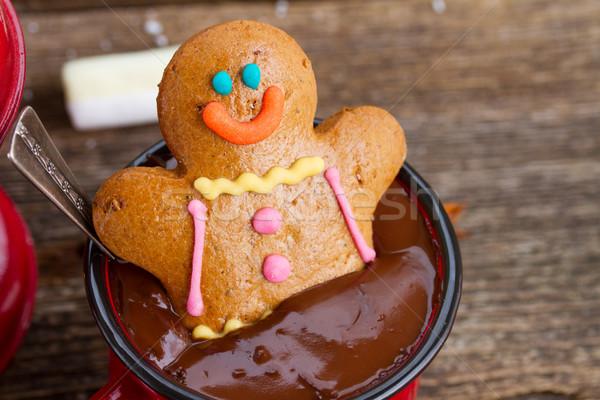 Mézeskalács ember forró csokoládé bögre fa asztal étel boldog Stock fotó © neirfy