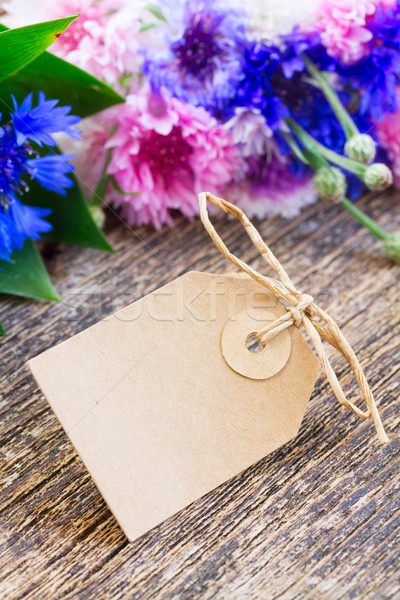 Paper note and Blue cornflowers Stock photo © neirfy