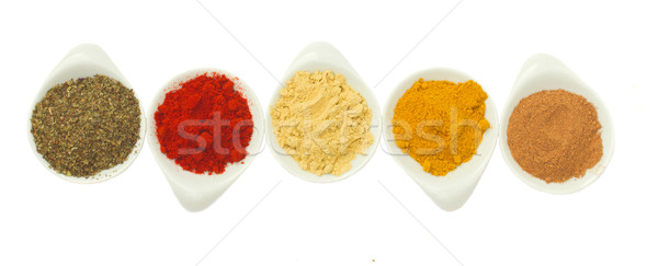 row of spices on white Stock photo © neirfy