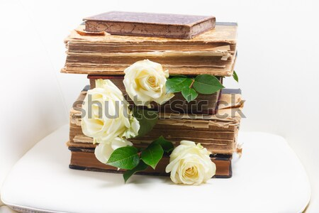 Stock photo: Old books with flowers