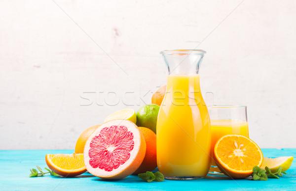 Agrios jar vidrio naranjas frutas fondo Foto stock © neirfy