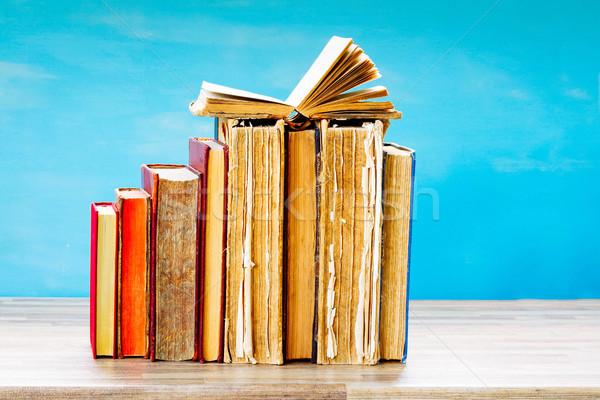 Köteg öreg könyvek nyitva egy fából készült Stock fotó © neirfy