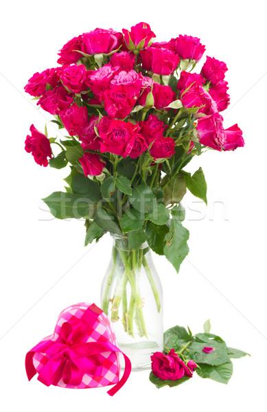 Köteg friss mályvaszínű rózsák üveg váza Stock fotó © neirfy