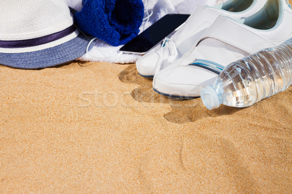white sneakers with hat in sand  Stock photo © neirfy