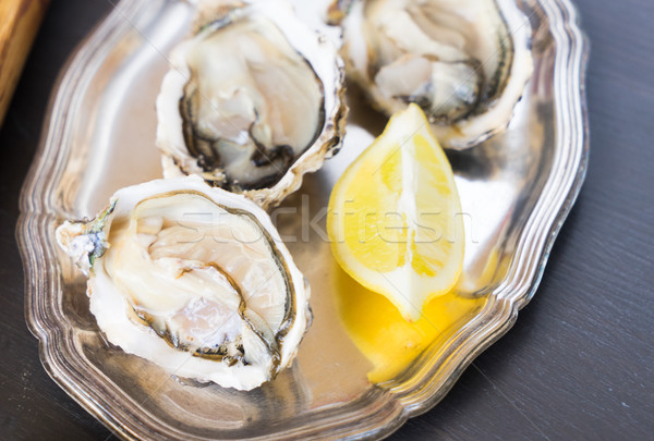 Raw oysters shells Stock photo © neirfy