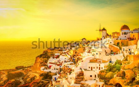 Moinho de vento pôr do sol santorini vintage cartão postal cidade Foto stock © neirfy