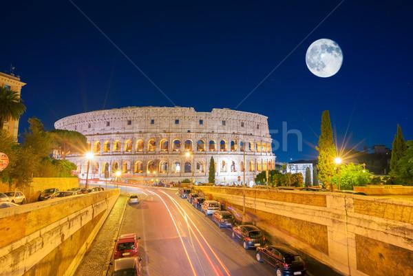 Colosseum kilátás megvilágított közlekedési lámpa hold égbolt Stock fotó © neirfy