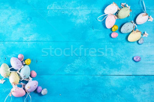 Easter eggs on blue Stock photo © neirfy