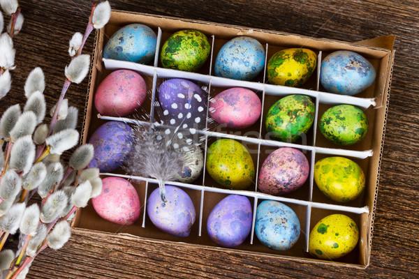 Pâques oeufs colorés boîte haut vue fleurs Photo stock © neirfy