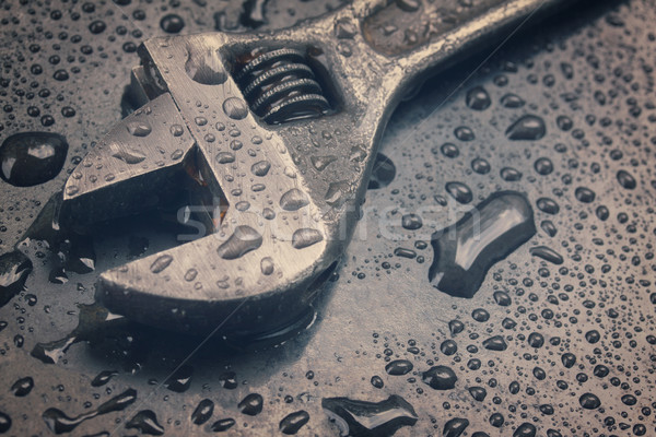 Adjustable Spanner In Water Drops Close Up Stock Photo
