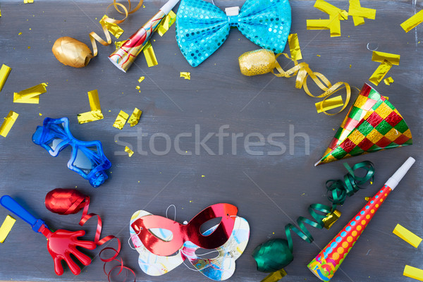 Masquerade decorations on dark wooden background Stock photo © neirfy