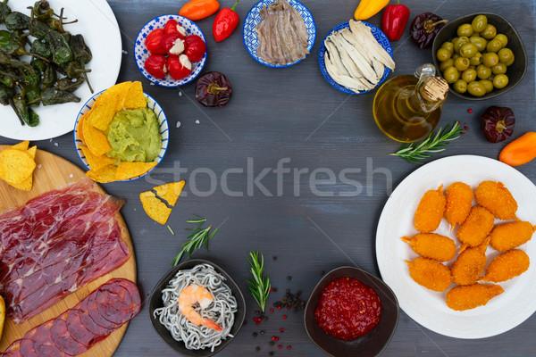 Tabela espanhol tapas pimentas quente salsa Foto stock © neirfy