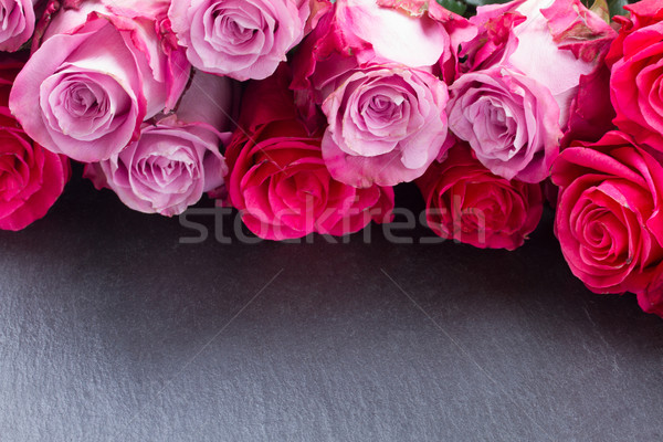 Stock photo: red and pink  roses  on table